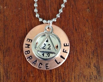 Recovery date pendant with symbol