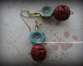 Czech Turquoise and Cinnabar Carved Beads hang from a Gold Finish Earring Findings