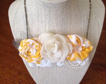 Yellow rosette bib necklace
