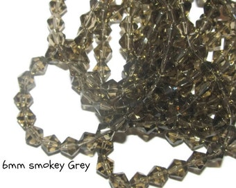 50 - 6mm Glass Bicones - grey (082)