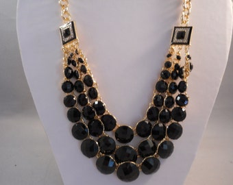 3 Strand Bib Necklace with Gold Tone and Black Beads on a Gold Tone Chain