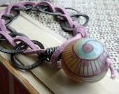 Labrynith bracelet- featured in Create jewelry magazine. lavender leather bracelet. lampwork bead. leather wrap bracelet.  Jettabugjewelry