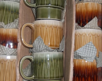 Vintage 10 piece set of coffee cups circa 1960 blue, green, gold and brown the color of the times. Never used