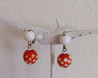 vintage. EARRINGS.  polka dots. ORANGE. clip on. WHITE. 1960s.