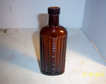 1910's Bottled by Jeyes 6  inch tall amber poison Bottle
