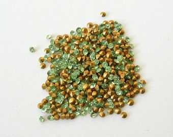 100 Swarovski Peridot light green chatons crystals with gold foil. 10pp 1.6-1.7mm