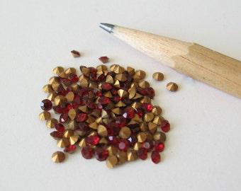 50 Swarovski Siam red crystal rhinestone chaton with gold foil. SS7  2.1-2.3mm