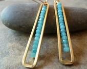 Blue agate swing earrings.