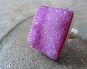 Sophisticated pink druzy cocktail ring set in silver.