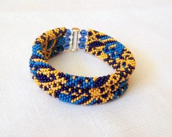 Beadwork - 3 Strand Bead Crochet Rope Bracelet in orange, blue and dark blue - beaded jewelry - beaded bracelet