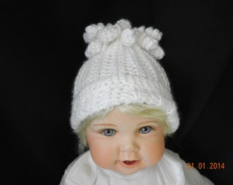White Baby Crochet Hat with Curly Top.  Soft acrlic yarn in ribbed pattern and rolled edge.