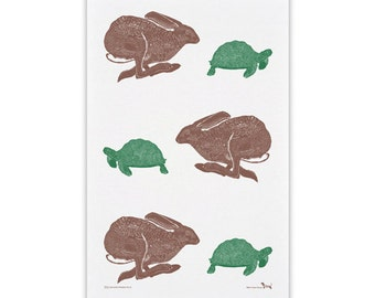 100% cotton tea towel with Hare and Tortoise