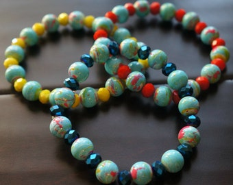 This bracelet is made with 6mm glass crystal beads and 10mm splatter paint beads