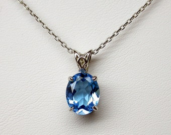 Genuine  Swiss blue topaz 2 ct  hand made sterling silver pendant  10 mm by 8 mm