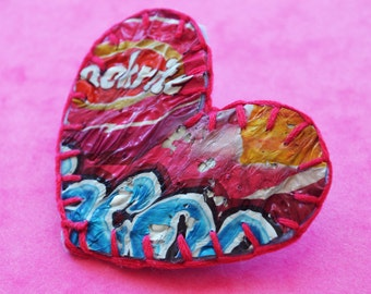 Valentine love heart brooch handmade from recycled plastic crisp packets. Unique, textural, pink, blue, embroidered cotton, great gift idea
