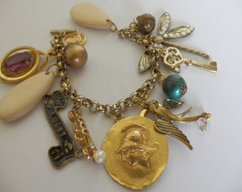 Reinvented upcycled charm bracelet- dragonfly,beads,luckycharm,birds,claddagh charm etc
