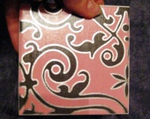 Pink drink coasters with black swirl pattern, Black swirls with silver, Coasters with silver and black color.