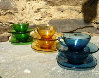Six French 'vereco' blue green and amber, glass coffee/espresso/tea cups and saucers