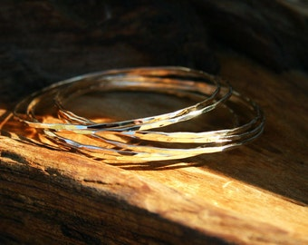 14k solid gold bangle. Gold bangle set. Gold bangle bracelets - single, set of three, five or seven. Hammered handmade jewelry Modern rustic