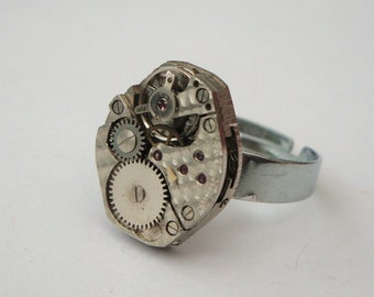 Steampunk ring watch movement torch soldered onto silver plated base vintage mechanical mechanism