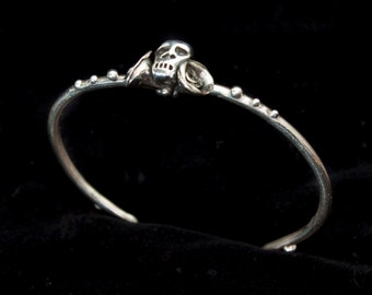 Sterling silver scull and rose bangle.