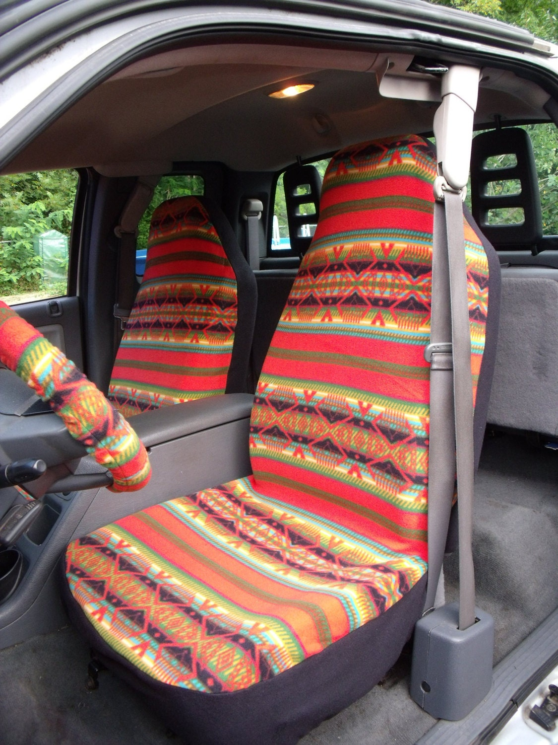 1 Set Of Orange Aztec Print Seat Covers And Steering Wheel