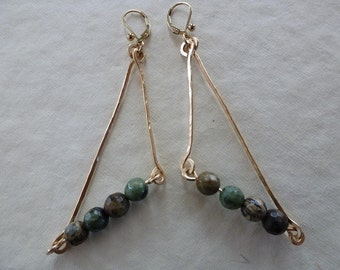 hand forged gold sticks and green opal stones triangulate naturally as Sticks And Stones Earrings