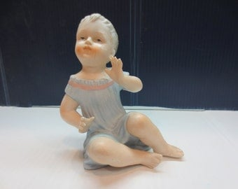 Vintage Bisque Porcelain Piano Baby Figurine
