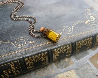 Amber Colored Glass Vial with Mouse Ribs on a Chain Necklace