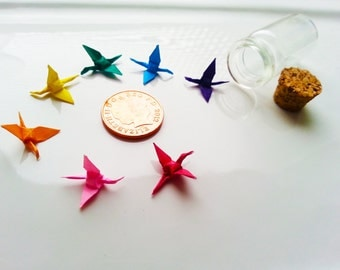 Tiny Origami Paper Cranes in Bottle.