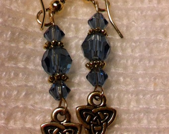 Denim blue and gold plated pierced earrings with Celtic charms.