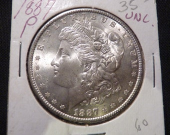 1887 P Uncirculated Morgan Silver Dollar UPDATED PRICE: Now 60 Dollars Plus Shipping.
