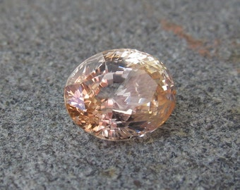 Peach sapphire loose gemstone oval cut 3.11ct unheated.