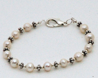 Ceremonial white fresh water pearl bracelet