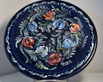 "A Dark Blue 11"" Stoneware Plate Hand Painted in an Original Design in a Rosemaling, Folk Art Style.  #P11045"