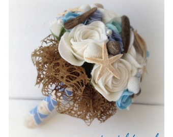 Handmade alternative wedding bouquet of ivory and blue felt roses with a seaside theme