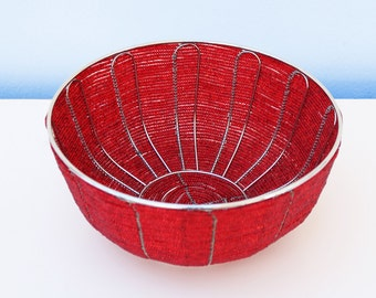 Red beaded bowl: Fun and funky, this simply stunning beaded bowl resonates with African joy and vibrant red colours.