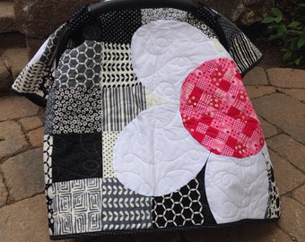 Car seat canopy- pink and white daisies on a black and white background