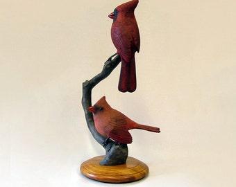 "Wood sculpture of Northern Cardinals entitled, ""Love Struck."""