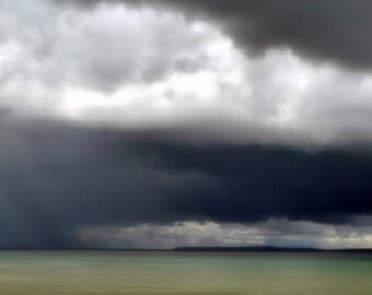 photo of Storm Clouds over Mackinac Island and The Mackinac Bridge  on the straits of Mackinac Mihigan