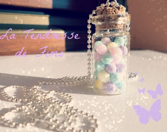 Bottle of sweets and candies as necklace