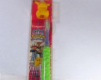Vintage Colgate Pokemon toothbrush and holder.