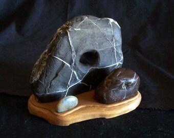 La Famiglia is a rock stone sculpture