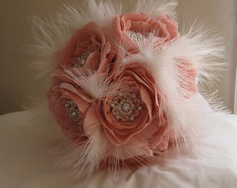 Beautiful handmade bridal bouquet of artificial dusky pink peony roses, rhinestone brooches and white feathers