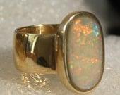 lady's ring  black australian opal 14k gold zise 5.-9. Custom orders ,pre order stone selections.