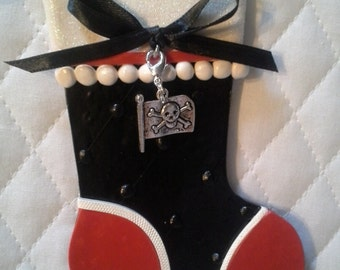 pirate Christmas ornament with crossbones flag charm.