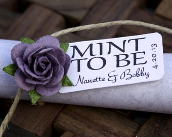 Purple roses with personalized favor tags to decorate wedding decor