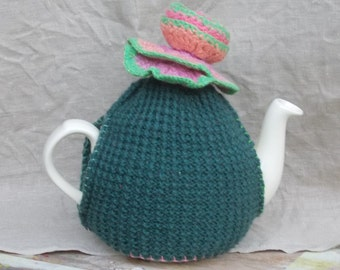 knitted woollen tea cosy with felted flower