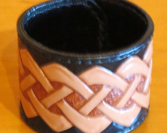 Wrist band, all leather hand carved and tooled
