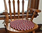 "Hand braided chair pad 15"" diameter red, cream and blue"